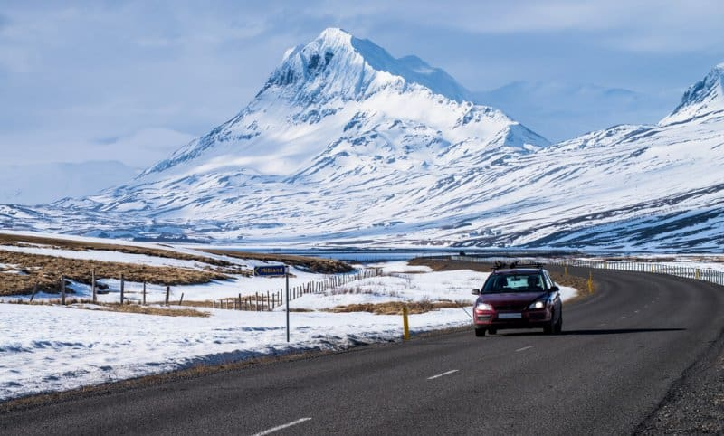 Driving down the snowy road in Iceland in winter