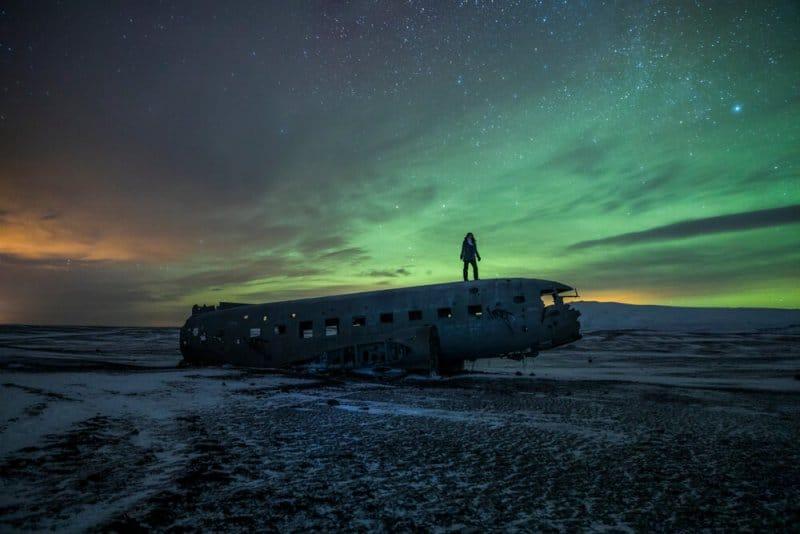 DC-3 plane wreck at Solheimasandur beach with the Northern Lights