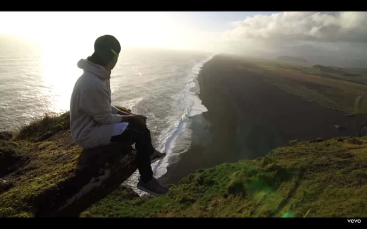 Justin Bieber sits on a cliff edge in Iceland for his video I'll Show You