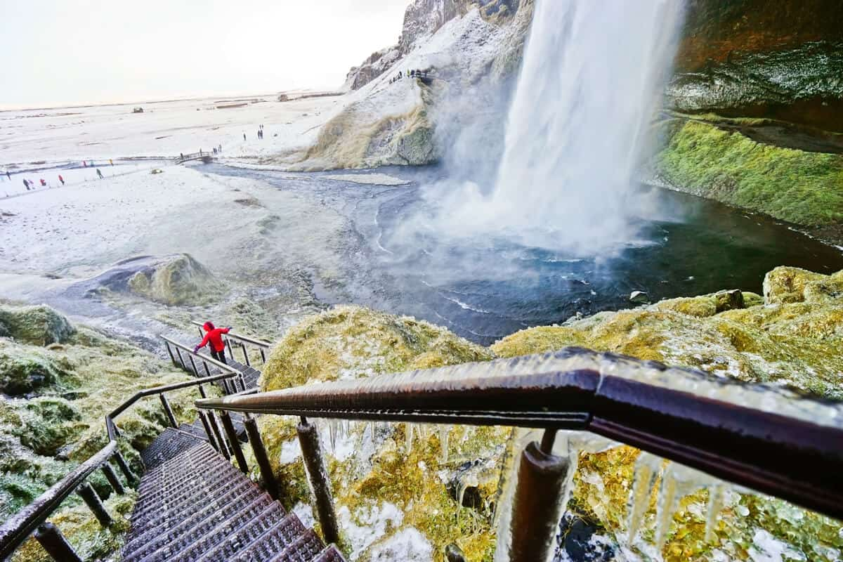 Stay on the marked paths at Seljalandsfoss. The rocks are slippery