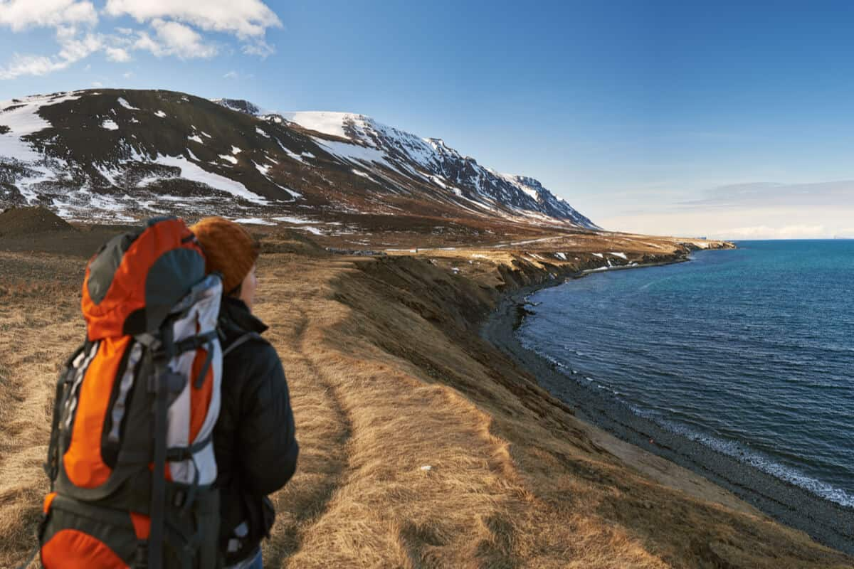 Iceland solo travel backpacker exploring the coast
