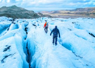 tourists hiking on a glacier in Iceland