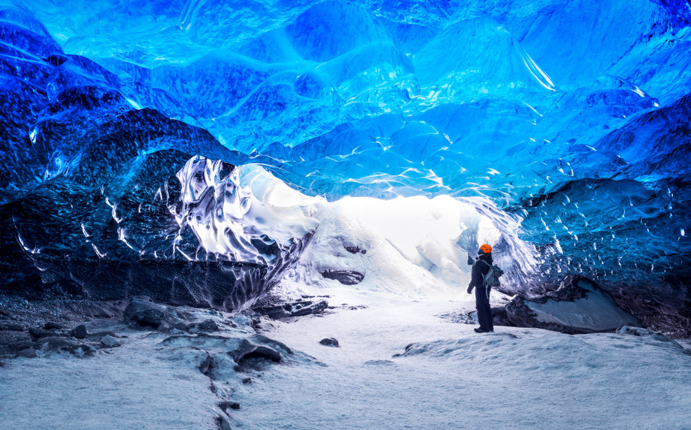 Visiting an Icecave in a glacier in Iceland