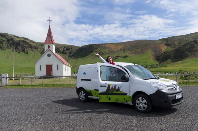 Tourist saying hello from her camper in Vík - Solo Van Camping Trip in Iceland