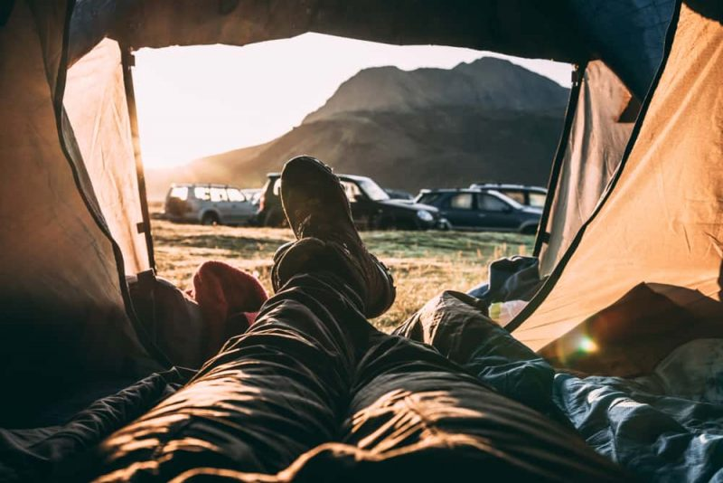 Tourist is resting in his tent - Solo Van Camping Trip in Iceland